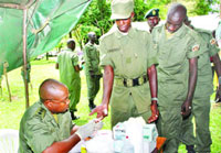 Captain Dr. Lawrence Basaaliza takes blood samples from Presidential Guard Brigade soldiers in Entebbe yesterday